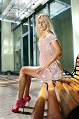 stock photo of school-leaver  - Beautiful blonde woman on a bench is waiting job interview - JPG