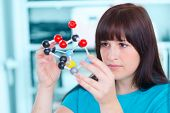 picture of molecules  - girl student holding a model of chemical molecules - JPG