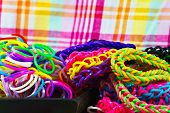 stock photo of rubber band  - colorful Rainbow loom bracelet rubber bands fashion close up - JPG