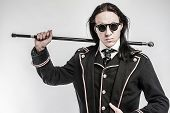 stock photo of drama  - Steampunk gentelmen costume drama character shot in studio on white background - JPG