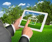 stock photo of public housing  - Man using tablet pc with symbols of public service and house - JPG