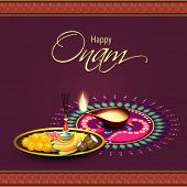foto of onam festival  - Illuminated oil lit lamp with sweets - JPG