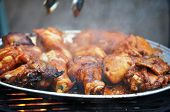 picture of barbie  - Chicken wings and thighs cooking on a barbeque - JPG