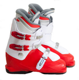 stock photo of ski boots  - Modern ski boots for young boy isolated on white background - JPG