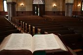 stock photo of pews  - open bible facing pews - JPG