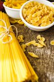 picture of kindness  - Different kinds of italian pasta like a fusilli farfalle spaghetti and penne pasta - JPG