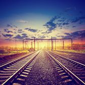 image of polaroid  - Landscape with the railroad under dramatic sky in style polaroid - JPG