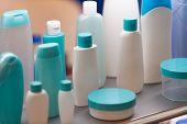 picture of plastic bottle  - Blue and white plastic bottles or containers for cosmetics - JPG