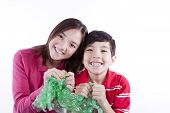 stock photo of irresistible  - A brother and sister getting ready to pop bubble wrap - JPG