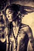 picture of headdress  - American Indian in traditional costume and headdress of feathers - JPG