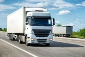 picture of trucks  - White truck on road - JPG