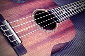 picture of ukulele  - Close up of ukulele selective focus with vignette - JPG