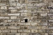picture of weeping  - Texture of old stone block retaining wall with weep hole for draining - JPG