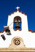 stock photo of blue-bell  - White Orthodox Greek church against a bright blue sky - JPG