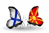 foto of macedonia  - Two butterflies with flags on wings as symbol of relations Finland and Macedonia - JPG