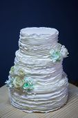 pic of three tier  - Beautiful white wedding cake on a table
