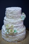 foto of three tier  - Beautiful white wedding cake on a table