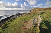 pic of southwest  - Seat on the southwest coast path near Croyde village looking towards Baggy Point headlandNorth Devon England - JPG