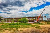 pic of construction crane  - Building under construction at a construction site with a truck and a crane - JPG
