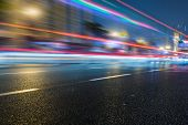 picture of speeding car  - speeding lights of cars in city at night - JPG