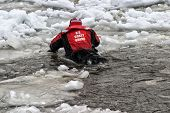 image of coast guard  - Coast Guard doing winter rescue training on an ice flo in lake Michigan - JPG