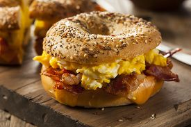 stock photo of breakfast  - Hearty Breakfast Sandwich on a Bagel with Egg Bacon and Cheese - JPG