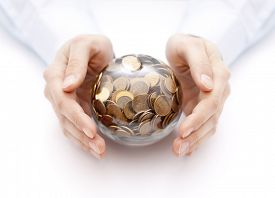 stock photo of oracle  - Crystal ball with money in hands - JPG