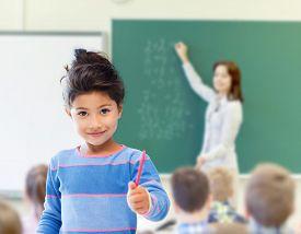 stock photo of little school girl  - education - JPG