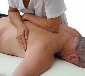picture of therapist  - Female sports massage therapist applying pressure to male prone client using forearm and body weight - JPG