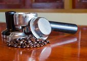 stock photo of brew  - Coffee Beans and Coffee Brewing Machine Parts - JPG
