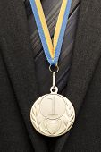 picture of gold medal  - businessman with gold medal Close up shot - JPG