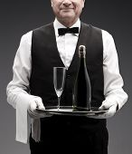 picture of flute  - butler with champagne bottle and flute on tray - JPG