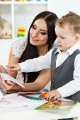 foto of young baby  - Mother and son playing and learning - JPG
