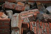 pic of dumpster  - Bricks in a dumpster near a construction site home renovation - JPG