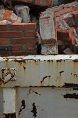 image of dumpster  - Bricks in a dumpster near a construction site home renovation - JPG