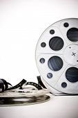 picture of mm  - 35 mm movie cinema reels with film unrolled vertical frame on white background - JPG