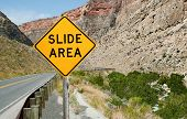image of northeast  - A sign informs motorists of a rock slide area ahead on a mountain road in northeast Wyoming - JPG