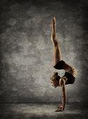 foto of upside  - Hand Stand Woman Handstand Girl Acrobat Performer doing Hands Standing Upside Down - JPG