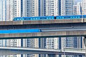 picture of high-speed train  - high speed train on bridge in hong kong downtown city at day - JPG