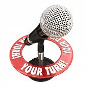stock photo of public speaking  - Your Turn words around a microphone to illustrate sharing an opinion and speaking one - JPG