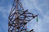 foto of mast  - high voltage post at sunset - JPG