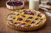 pic of tarts  - Shortbread tart with cherries with beautiful grid sprinkled with almonds - JPG