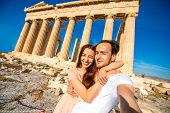 foto of parthenon  - Young couple travelers taking selfie picture with Parthenon temple on background in Acropolis in Athens - JPG