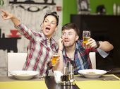 pic of take out pizza  - Young man and young woman feed pizza to each other - JPG
