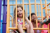 pic of tongue  - Cute girl sticking her tongue out on playground - JPG