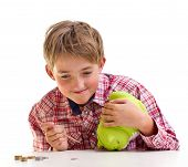 image of thrift store  - The boy gets money from the piggy bank - JPG