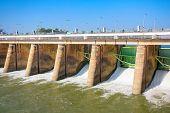 image of dam  - Water rushing through gates at a dam in Kanchanaburi province - JPG