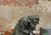 picture of gas mask  - Man with gas mask and green military clothes explores small plant after chemical disaster - JPG
