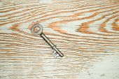 image of hasp  - Vintage key from the lock on a wooden texture - JPG
