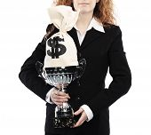 image of money prize  - business woman holding trophy and money bag isolated on a white background - JPG
